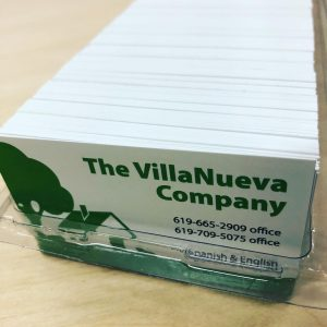 Stack of business cards printed in-house