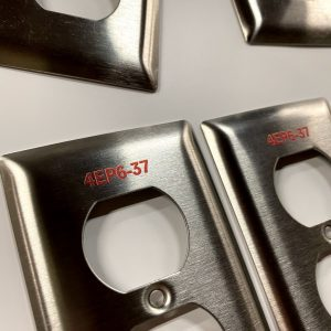 Laser marked switch plates