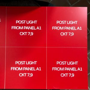 Laser engraved number plates with white letters on red