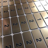 UV printed acrylic seating numbers on sheets