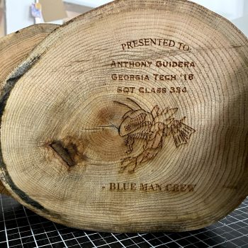 Laser engraved patterns in stump of wood