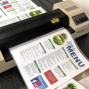 Menus being laminated