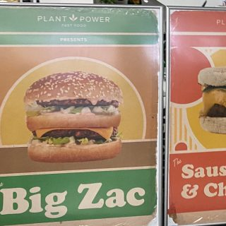 Two large printed signs for a restaurant