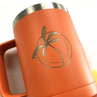 Laser engraved tumbler with handle