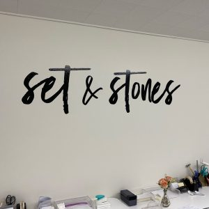 Wall graphics reading Set In Stone