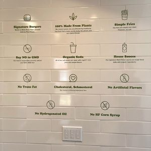 Applied vinyl wall graphics of a Plant Power Menu